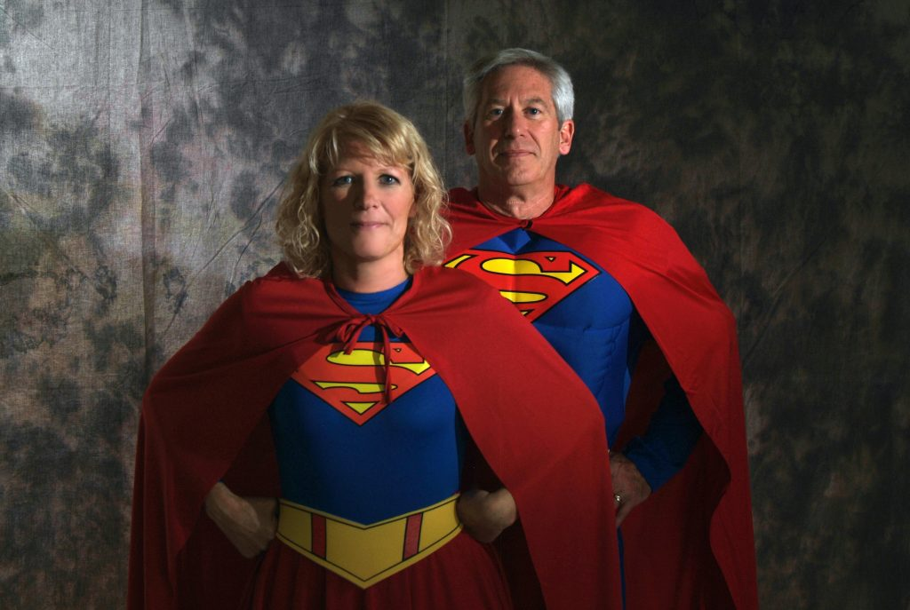 superman and woman costumes