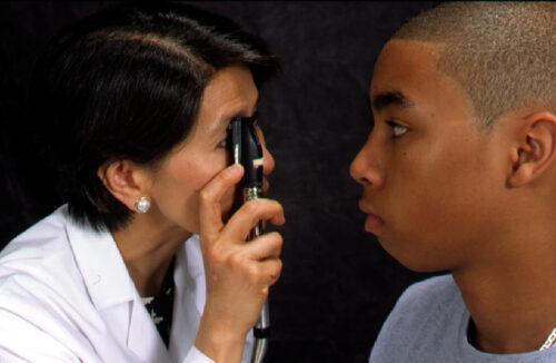 Optometrist doing low vision assessment